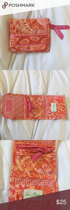 Vera Bradley wallet Sherbet Super cute Vera Bradley wallet in pattern Sherbet (discontinued). Has zipper coin pouch inside above a card pouch with plastic cover and a third card pouch at the bottom. Velcro closure. Cute vibrant colors with a pink gingham pattern inside. Comes from a smoke free and pet free home. Matching tote bag also available in my closet! Vera Bradley Bags Wallets