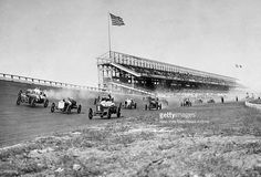 Autos raise the dust at Sheepshead Bay Race Track during a ban on horse racng imposed by Gov. Charles Evans Hughes.