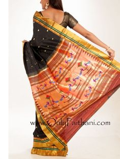 Stunning black #paithani saree with a golden weave border and paisley buttis