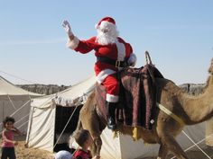 Santa claus riding camel