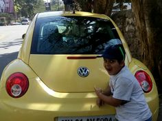 With his favourite Volkswagen Beetle #Champ