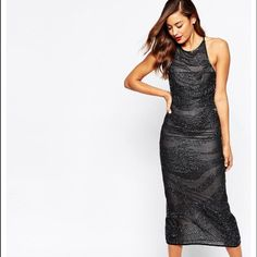 Black embellished dress Embellished woven fabric Round neckline Racer-cut styling Open back with cross strap detail Zip back closure Kick split Slim fit - cut closely to the body Hand wash  100% Polyester ASOS Dresses Midi