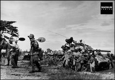 On the road from Namdinh to Thaibinh. May 25th, 1954. French troops with mine detectors//Robert Capa