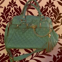 Mint Green Steve Madden Tote Bag NEW This beautiful Steve Madden bad is a gorgeous mint color. I bought it a while bag and never had the chance to use it. It's in perfect condition with no marks or blemishes.  It features a cute quilted pattern the front, beautiful chain and tassel details in gold, 2 hand straps and a cross body strap.  Inside features 2 pockets and 1 zipper pocket.  Purse zips closed.  Made from a faux leather material that is super soft! Steve Madden Bags
