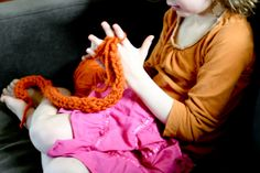 flax & twine | craft + diy: Finger Knitting How-to  My son is learning to finger knit in his 1st grade class so I wanted to learn as well.  I discovered Anne Weil's super easy finger knitting tutorial on her blog, Flax & Twine.  I completed a nice long piece in about 20-30 minutes. I used a chunky yarn like she recommends for starting out.  These would make great garlands for festive decorating or a fun scarf or wrist cuff and it is a great activity to keep hands occupied.