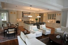 An open kitchen/dining/living room. Love the pendants over the island. Get this look with the Quinn Pendant http://www.kichlersuperstore.com/lights-ceiling-lights-kichler-pendant-lighting-p/42252AP.htm