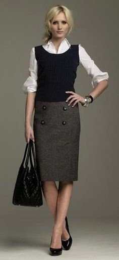 Stay warm at the office in winter: Simple grey wool skirt with a white long sleeve and black wool vest.