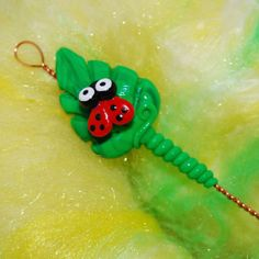 Leaf with Ladybug Spinning Wheel Orifice Hook by TheClaySheep