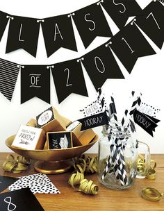 Looking for last-minute touches to tie your graduation party together? Jazz up your party using our free printable décor suite.  The trendy black and white banner can be paired with your school colors and includes 2016-2018 artwork so you can use it for years to come! Hang it on the front door to