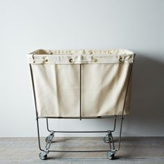 I need this for my new apartment! Elevated Laundry Basket - from @Food52