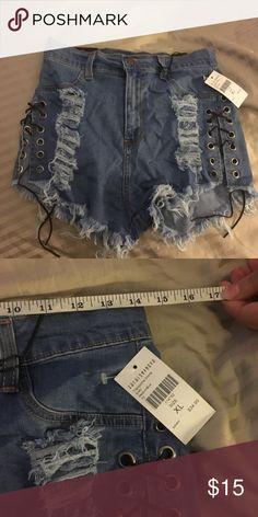 "ceccbcec7972 Lace up jeans Runs small !! Waist measures 28"" Fashion Nova Shorts Small  Waist"