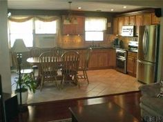 Not So Ordinary Raised Ranch Ranch Raising and Living rooms