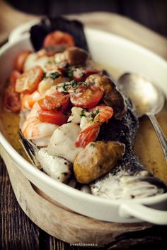 Fish with mushrooms and shrimp