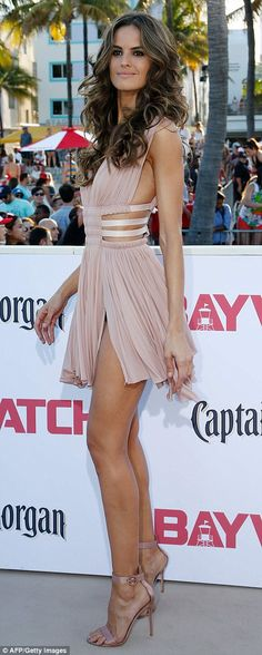 Standing tall: She boosted her height in a pair of strappy nude heels...