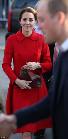 The Duchess of Cambridge wore a brilliant pillar box red coat for her engagements in Whitehorse, Yukon, on Wednesday