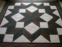 Quiltscapes.: A Carpenter's Star by a mother and her triplet daughters.