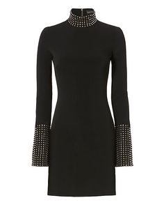 David Koma Studded LBD: Studded detailing at high neckline and flared long sleeve cuffs gives this LBD its rock-n-roll aesthetic. Exposed zip at back. Lined. In black. Fabric: 52% ac/45% vi/3% ea Trim: 100% acrylic Lining: 96% ac/4% ly Made in UK.     Model Measurements: Height ...