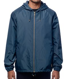 Protect yourself from harsh weather conditions without compromising fashionable style with the Brixton Claxton Navy Hooded Windbreaker Jacket. Brixton had made this jacket from a nylon/polyester blend and it features a zip closure, adjustable drawstring h
