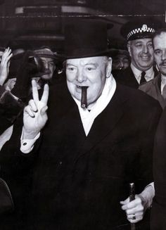 Winston Churchill giving his famous victory sign