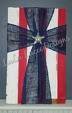 Americana Burlap Cross 10x17 inches Red and white distressed wooden background. Blue Burlap Rhinestone star pendant