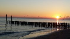 Ondergaande zon strand Koudekerke