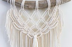 A macrame wall hanging is the easiest way to add a little bohemian style to any home. This delicate macrame pattern on an aged Pine Branch will complement your existing decor. This macrame wall hanging features a delicate scalloped pattern created with beige 3mm 100% cotton