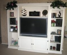 Like the basic style of this entertainment center.  Has cut list and instructions on how to make it yourself.