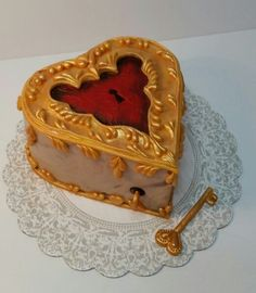 Music Box Cake - My heart to you is given; do give yours to me; we'll lock them up together, & throw away the key.  Deep red velvet cake, swiss buttercream & fondant decorations.