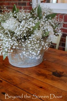 Babys breath with white flowers in galvanized buckets tying the babys breath white hydrangeas and acuba leaves in an old galvanized bucket simply lovely mightylinksfo Gallery