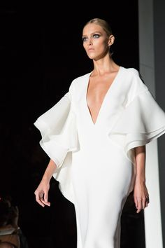 Long white dress with cascading ruffle sleeves - modern elegance; sculptural fashion details // Gucci