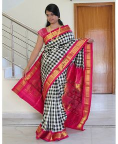 Pure paithani silk saree in checkered design in rich zari pallu with peacock motifs. It comes with an unstitched running blouse fabric
