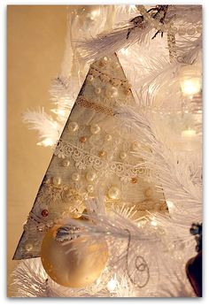 Christmas Tree ornament ... white or Christmas fabric sewn with batting in the middle then embellished with lace, beads, etc. on both sides