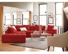 Handcrafted Design. Built for durability and versatility, the Venti Red collection by Kroehler™ is an oversized sectional that will round out your living room with looks and longevity. This collection is upholstered, tailored, and handcrafted by skilled craftsmen. It's swathed in warm, vibrant cloth that feels luxurious against your skin and is tufted along all the attached seat and back cushions. Each section comes with two back pillows and wood block legs are almost invisible.