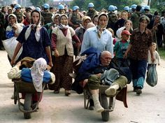 A group of Bosnian Muslims, refugees from Srebrenica, gather for transport from the eastern Bosnian village of Potocari in a July 13, 1995, file photo. (Reuters)