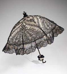 """Dupuy parasol ca. via The Costume Institute of The Metropolitan Museum of Art """"Featured, is an example of a fine French parasol created by Dupuy whose establishment was in the most. Lace Umbrella, Lace Parasol, Under My Umbrella, Victorian Era, Victorian Fashion, Vintage Fashion, Historical Costume, Historical Clothing, Belle Epoque"""