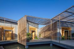 The Bamboo Courtyard Teahouse by Sun Wei of HWCD crosses traditional Chinese cultural and architectural traditions with contemporary aesthetics for an elegant and streamlined effect. The floating teahouse features inward-facing pavilions made of bamboo that define indoor/outdoor spaces, set adjacent to more solid brick structures.