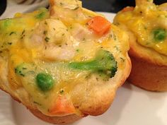 Cheesy Chicken Pot Pie Cups -- I made these little cups earlier this week for dinner. They were very easy and quick to make. These are fine for dinner but are perfect for anyone who takes their lunch to work. I thought they tasted okay but my husband loved them. I will be making these cups in the future and would recommend this recipe to anyone looking for a quick easy chicken pot pie like dish.
