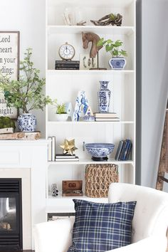 Natural elements and blue and white on these beautifully styled shelves