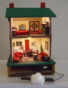 a 1:144 scale house - cool that it is all lit up, built by Amy Rauch