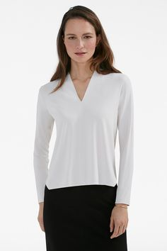 Combine a sculptural V-shaped neckline and loose silhouette, and you've got a work blouse that feels more like your favorite T-shirt.