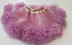 Beautiful ruffly baby tutu and flower baby skirt are the ideal first present baby! This light mauve tutu is made of a double layer of tulle and a layer of taffeta. With an elasticated waist for a comfortable secure fit, this skirt is perfect for any baby on the move. The set comes with a