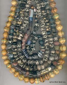 009 - African Trade Beads - This Week's Theme: Beads I found this intriguing collection of ancient trade beads on AfricanTradeBeads.com, a small English company specializing in the collection and supply of African trade…