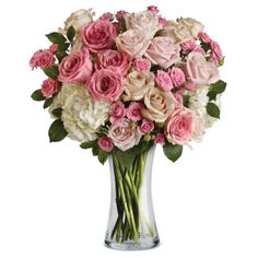 M18V Loving Mum. Roses in exquisite shades of pink and cream accented with hydrangea and delivered in a beautiful glass vase. She'll be totally swept away.