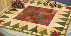 Add Special Touches with Beads and Buttons! This little quilt will be a wonderful addition to your holiday decor. Its small size makes it a quick project, and once completed it will be stunning on your table. The charming design is perfect for your favorite scraps. A simply pieced center surrounded by trees with stars …