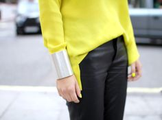 Neon yellow sweater and leather pants