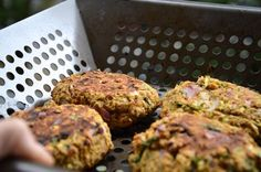 These spicy chickpea veggie burgers can be ready in less than 30 minutes! Make them on the BBQ or fry them in a pan for the perfect summertime dinner.