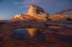 arizona's vermillion cliffs national park. the area is famous for its ferrous coloured petrified sand dunes, smoothed and wave like from ancient flash flooding, and the jurassic era petrified sandstone of white pocket, known for it's so called cauliflower rocks, formed as sand was lithified into rock from ancient earthquakes (hence 'sandstone').