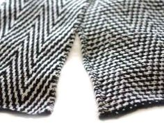 """""""quinn utilizes a two color slipped stitch pattern, resulting in a doubly thick and cozy fabric. the slipped stitch technique knits up much more quickly than if one were to replicate the design through fair isle. while the back is different from the front, the slipped stitches arrange themselves neatly and nicely into a """"purl-side"""" herringbone pattern."""""""