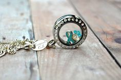 Teal Ribbon: Ovarian, cervical, and uterine cancers, sexual assault, polycystic ovarian syndrome, post traumatic stress disorder, and tsunami victims. Origami Owl® cause ribbons. What are you fighting for? www.jennamaley.origamiowl.com