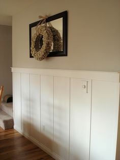 Board and batten wainscoting for stairwells: add accent colour above, keep b cream or off-white to reflect light.